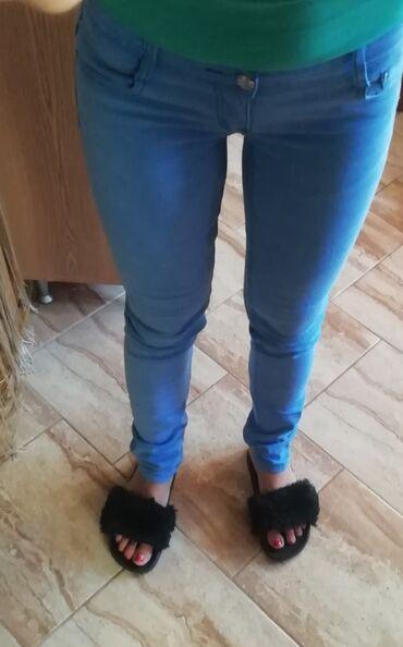 Zenske pantalo - Srbija: Zenske uske plave pantalone,velicina 28
