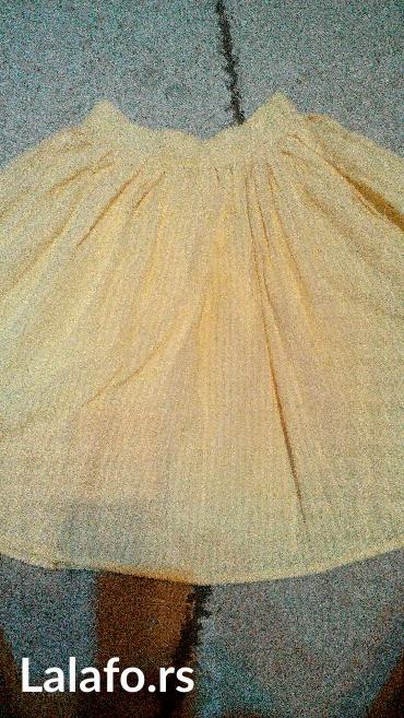 Preslatka žuta suknjica,obim 66cm,dužina 57cm kopca se sa strane na - Pancevo
