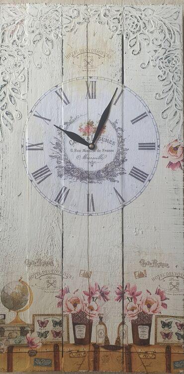 Kuća i bašta - Vrsac: Zidni sat dimenzija 27x53 cm. Sat je nov nekoriscen sa novim besumnim