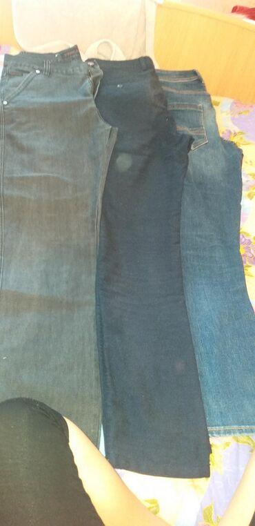 Отдам даром мужские джинсы, цвет: чёрный, синий. Спортивку чёрную. 2