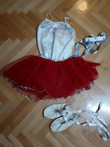 Crvena suknjica kao nova, bez ostecenja i fleka duzina 23 cm,  obim st - Nis
