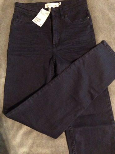 Zvonaste-pantalone-sa-dubokim-strukom-pol - Srbija: Nove hm frmerke teget boje sa dubokim strukom, nisu nosene, kupila sam