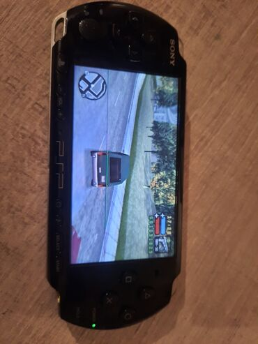 PSP (Sony PlayStation Portable) - Azərbaycan: PlayStation Portable PSP 3004 MODELI normal veziyyetdedir zaretqa