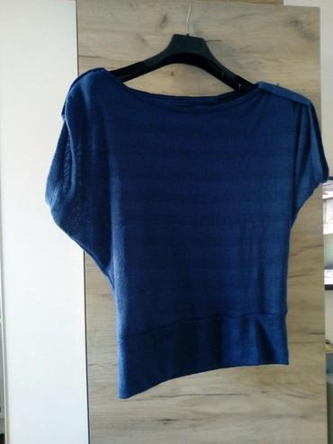 Koncana-roza-m-majica - Srbija: Majica koncanaKoncana majica teget boje.Velicine M/LLepo očuvana.Sve