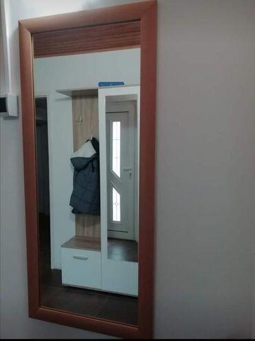 Ogledalo, dimenzije 112x50.Ram boja bukve, u odličnom stanju