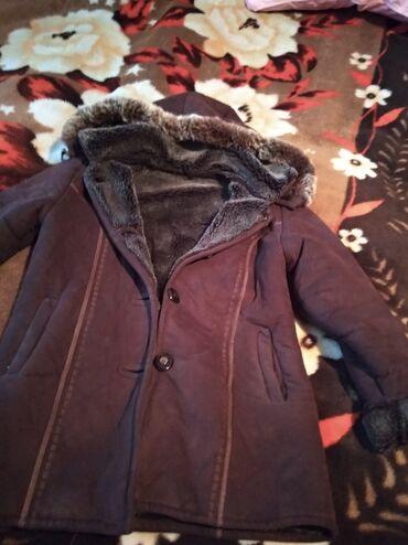 uşaq paltosu - Azərbaycan: Qalın uşaq (qız)paltosudur.10 -12 yaş uşaqlar üçündür. 10 man
