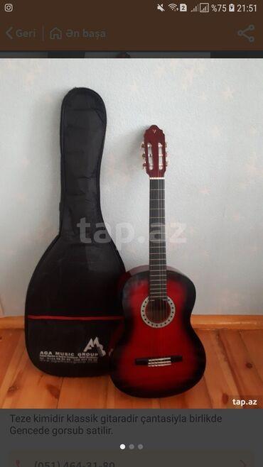 İdman və hobbi Gəncəda: Gitara teze kimidir. Çantasıda ustunde verilir. Heç bir problemi