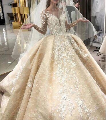 На прокат Платье мечты многих девушек  Вышывка ручной работы, платье L