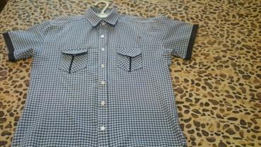 Рубашка на 46-48 размер.Есть ещё рубашки,брюки и другая одежда.Чтобы