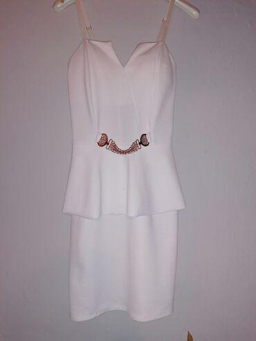 Bela haljina, idelana za neke vecernje prilike, kratka, uska, sa