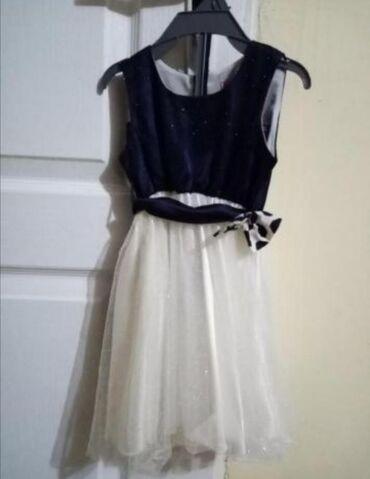 Decije haljine   Lazarevac: Prelepa haljinica, teget bele boje, vel 80,samo jednom nosena