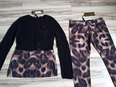 Костюм леопардовый - леггинсы и туника.Состав ткани - 70%