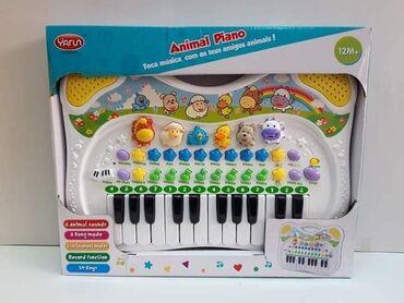 Muzika - Srbija: Muzički piano, svira, oponaša zvuke životinja 39x31cm 2400din