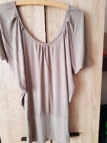 Ženska odeća | Negotin: Bluze kratkih ruakava, neobicnog kroja i modela vel. S