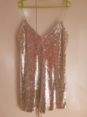 Srebrna haljina sa kvalitetnim sljokicama, jednom obucena, velicina L. - Belgrade