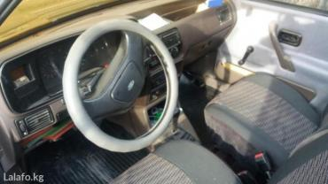 форд эскорт 87 год об 1. 6 бензин механика 5 ступка состояние хорошее  в Бишкек