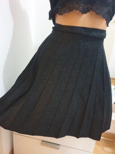 Suknja na faltice sa skroz sitnim sljokicana,duzina podesivavel s m