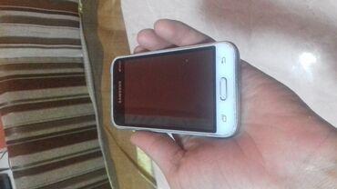 Мобильные телефоны и аксессуары в Душанбе: Б/у Samsung Galaxy J1 Mini 8 ГБ Белый