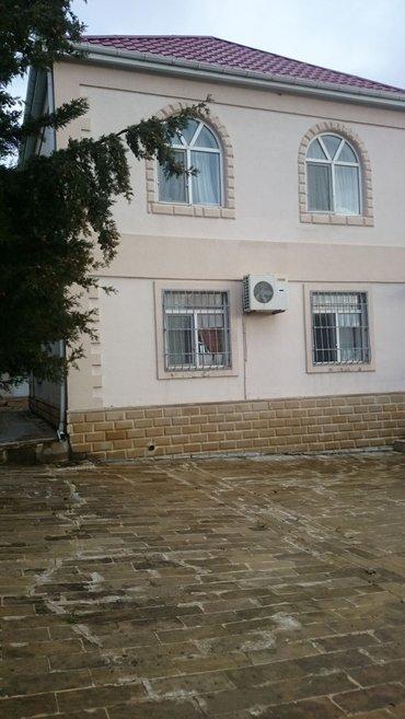 Bakı şəhərində Samaxinin mugamli kendinde bag evi saatilir 2 mertebeli 4 otaqli ela