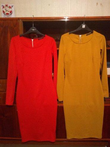 qırmızı bodilər - Azərbaycan: Paltar, qirmizi rengi-20m, xardal rengi-15