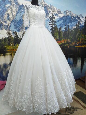 Токмок. Продаю свадебное платье размер 42-44 недорого,очень красивое и