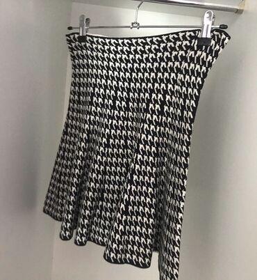 Trikotazna suknja  Velicina univerzalna  Kao nova