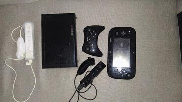 Wii-u američka verzija. Na internoj memoriji tri igrice mario kart 8