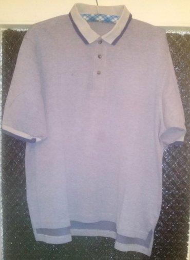 Majica Nike Golf.  Polo majica sa kragnom i kratkim rukavima. Malo - Beograd