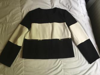Novi sako kupljen u svajcarskoj. Njihova velicina 42, odgovara - Uzice