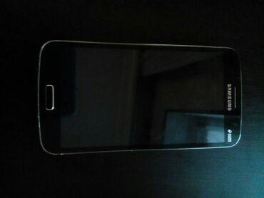 Samsung Grand 2. Adaptor verilir
