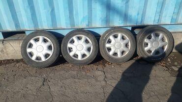 летние шины на 14 цена в Кыргызстан: 14 месте с дисками и калпаками 2 шт.зимный 2шт.летниее снята из тайота