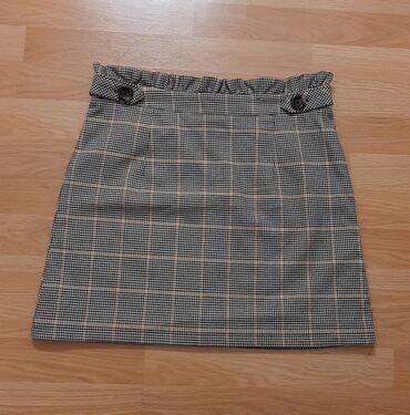 Primark karirana suknja je jednom nosena kao nova. Naznacena velicina