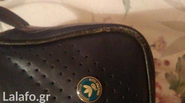 Adidas - Ελλαδα: Τσάντα adidas με ρυθμιζόμενο λουράκι