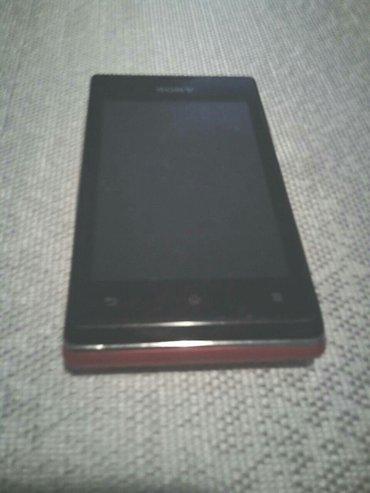 Sony xperija C1505 baterija ok,ima punjac ,crvene boje ,radi sve na - Rumenka