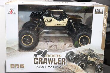 Пультовая машинка. Радиоуправляемая игрушка Monster Truck Rock