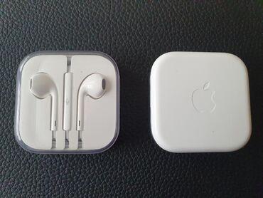 IPhone slušalice original, bele bojeCena jednih slušalica je 1500