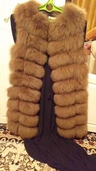 Женская одежда в Джалал-Абад: Продам меховую жилетку в новом состоянии. Длина 90 см. Покупала за 13
