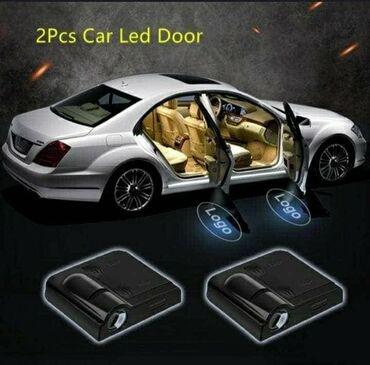 Led svetlo za vrata na magnet, logo BMW, u setu 2 kom Cena 1550 din
