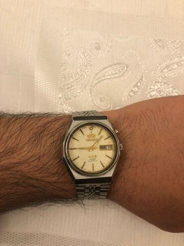 - Azərbaycan: Gümüşü Kişi Qol saatları Orient