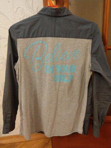 Рубашка от фирмы Benetton На 11-12 лет. Очень стильная, подойдет и с