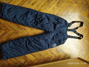 Radne tople postavljene pantalone na tregere kao nove.Vel M