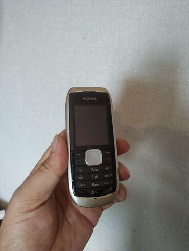 Nokia Azərbaycanda: Nokia 1800,Sade bashi ishiqli kamerasiz telefon.yeni kimi