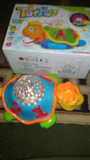Игрушки в Джалал-Абад: Игрушка музыкальная черепашка город Джалал абад