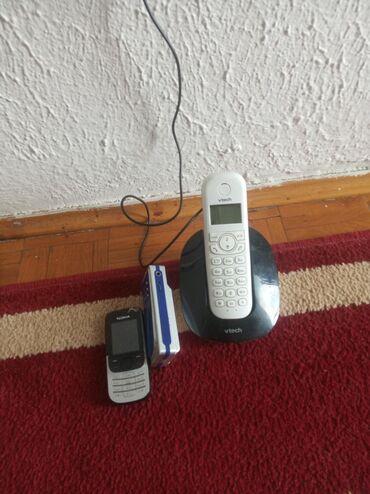 Fiksni telefon i Nokia 3210 ali ostecena