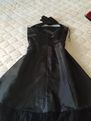 Svaku priliku haljina - Srbija: Svečana crna haljina.Do ispod kolena.Saten.Ima postavu.Deblje