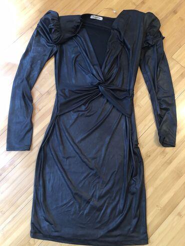 Zenska haljina u odlicnom stanju. Nosena samo jednom. Bukvalno kao