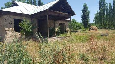 Участок и дом, находится в селе в Базар-Коргон