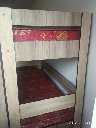 Продаётся двухъярусный б/у кровать с матрасом