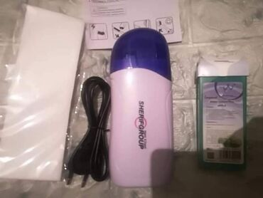 Paket sadrzi - Srbija: Set za depilacijusadrzi jedan aparat za topljenje voskajednu patronu