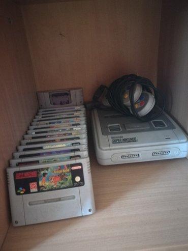 Lutka za butik - Srbija: Super Nintendo sa dosta ketridza i dobrih naslova za kolekcionare ili